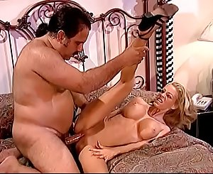 Blonde with fake tits Tabitha Stevens tempts fat dude and drinks her juices